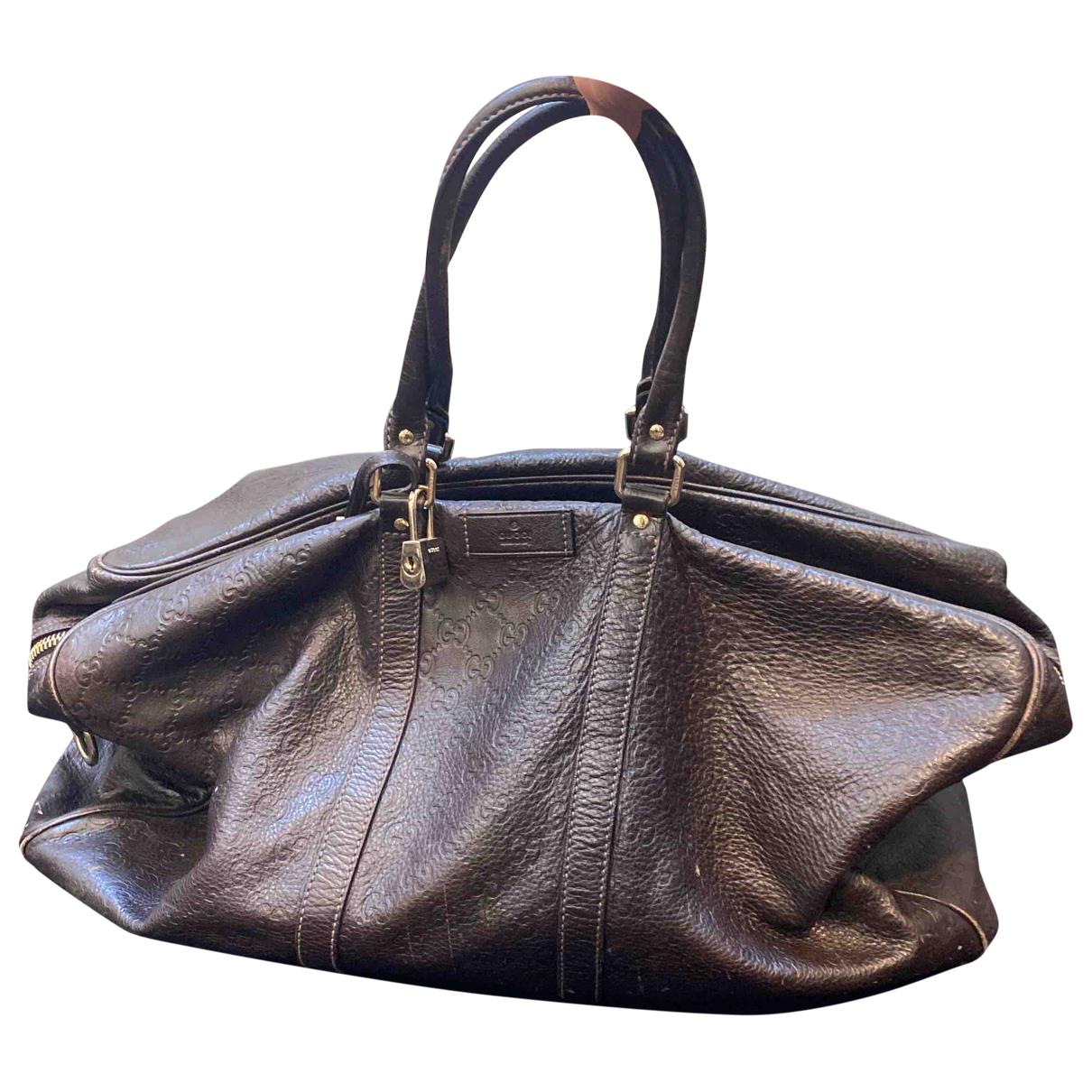 Gucci - Sac de voyage   pour femme en cuir - marron