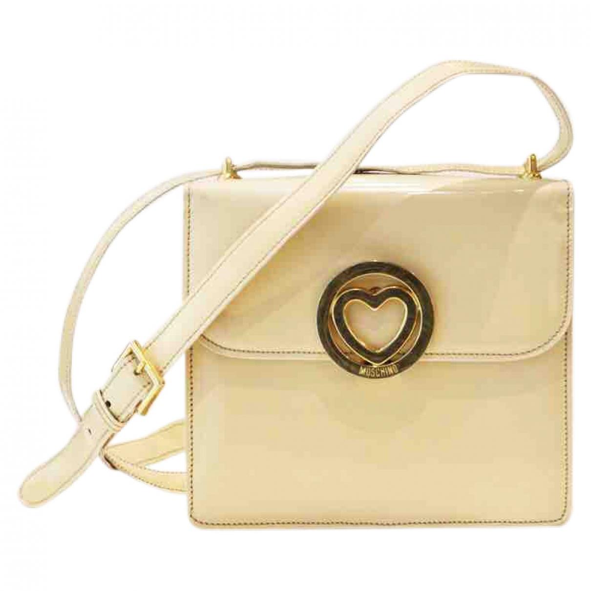 Moschino \N White Patent leather handbag for Women \N
