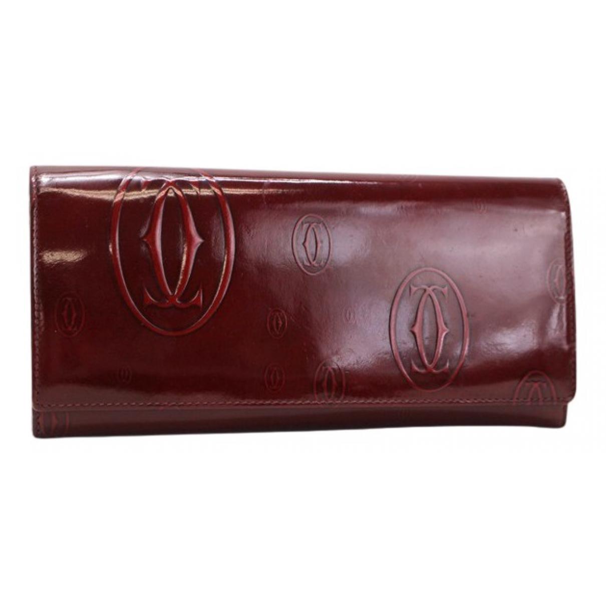 Cartier - Portefeuille   pour femme en cuir verni - bordeaux