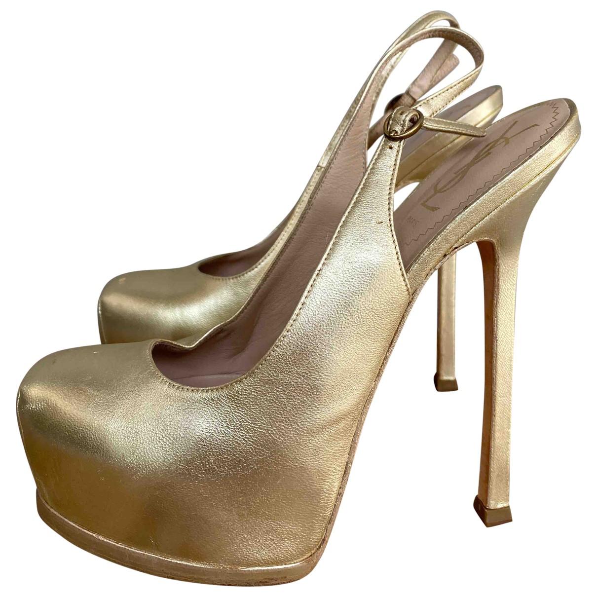 Yves Saint Laurent \N Clogs in  Gold Lackleder