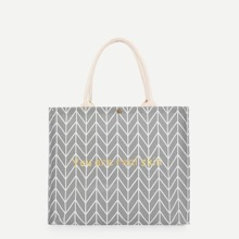 Bolsa de mano con patron geometrico de letra
