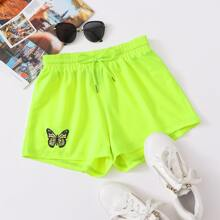 Neon Lime Shorts mit Schmetterling Stickereien und Kordelzug um die Taille