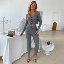 conjunto cardigan tejido de canale con boton con pantalones con cordon