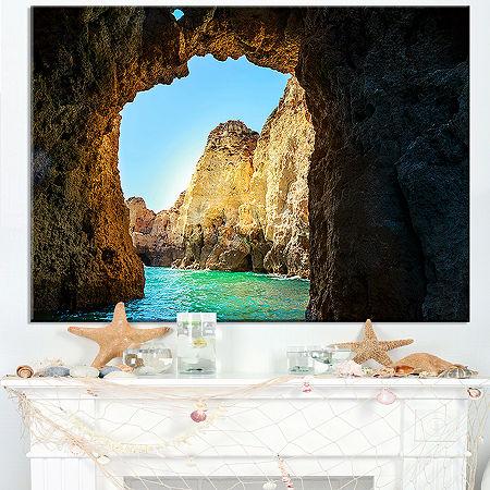 Designart Sea Through Rocky Cave Portugal Canvas Art, One Size , Blue