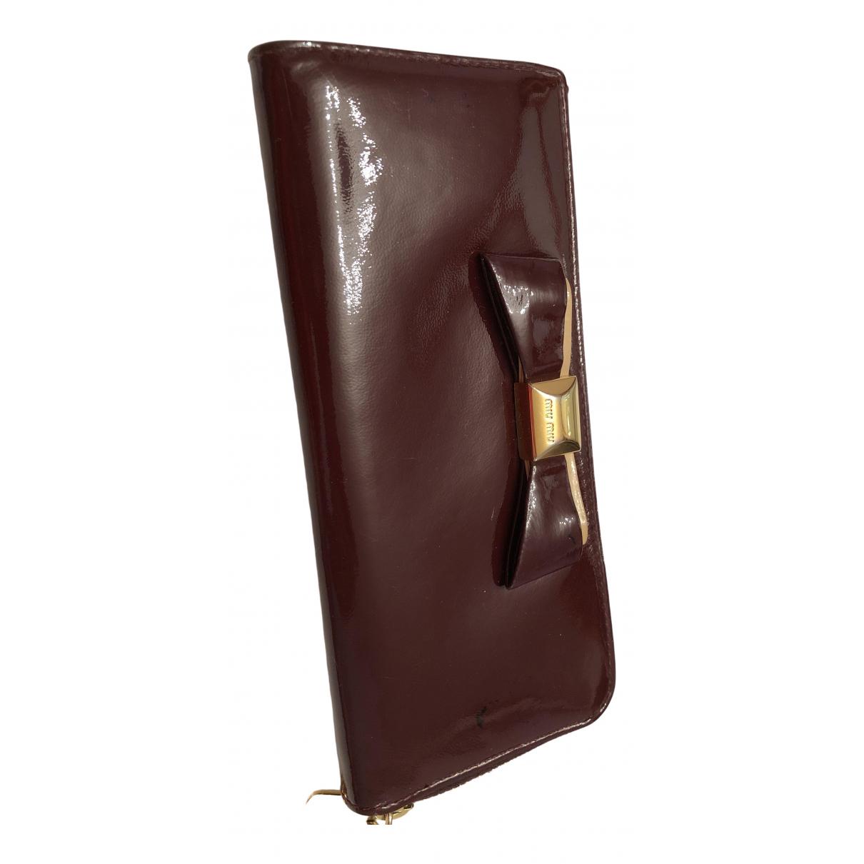 Miu Miu - Portefeuille   pour femme en cuir verni - bordeaux