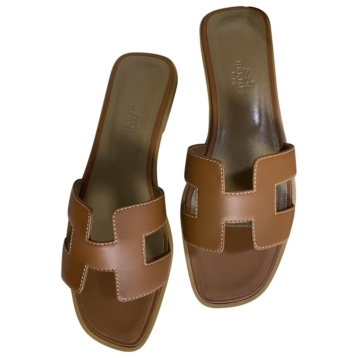 Hermes - Sandales Oran pour femme en cuir - dore