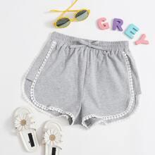 Shorts con cinta con encaje