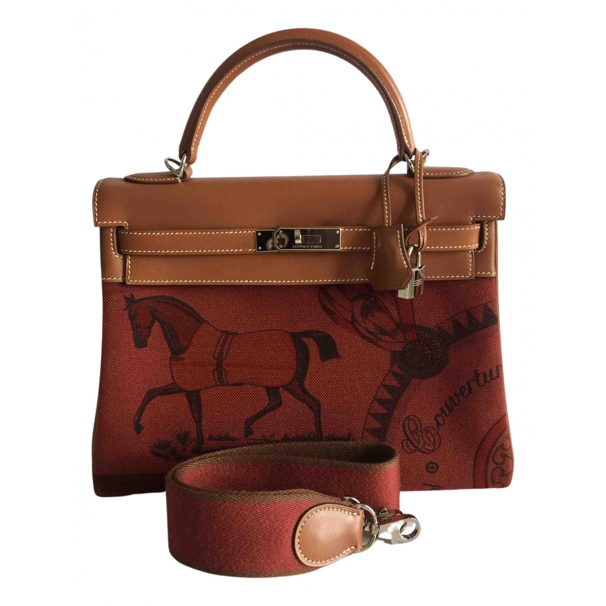 Hermes Kelly 32 Handtasche in  Bordeauxrot Leinen
