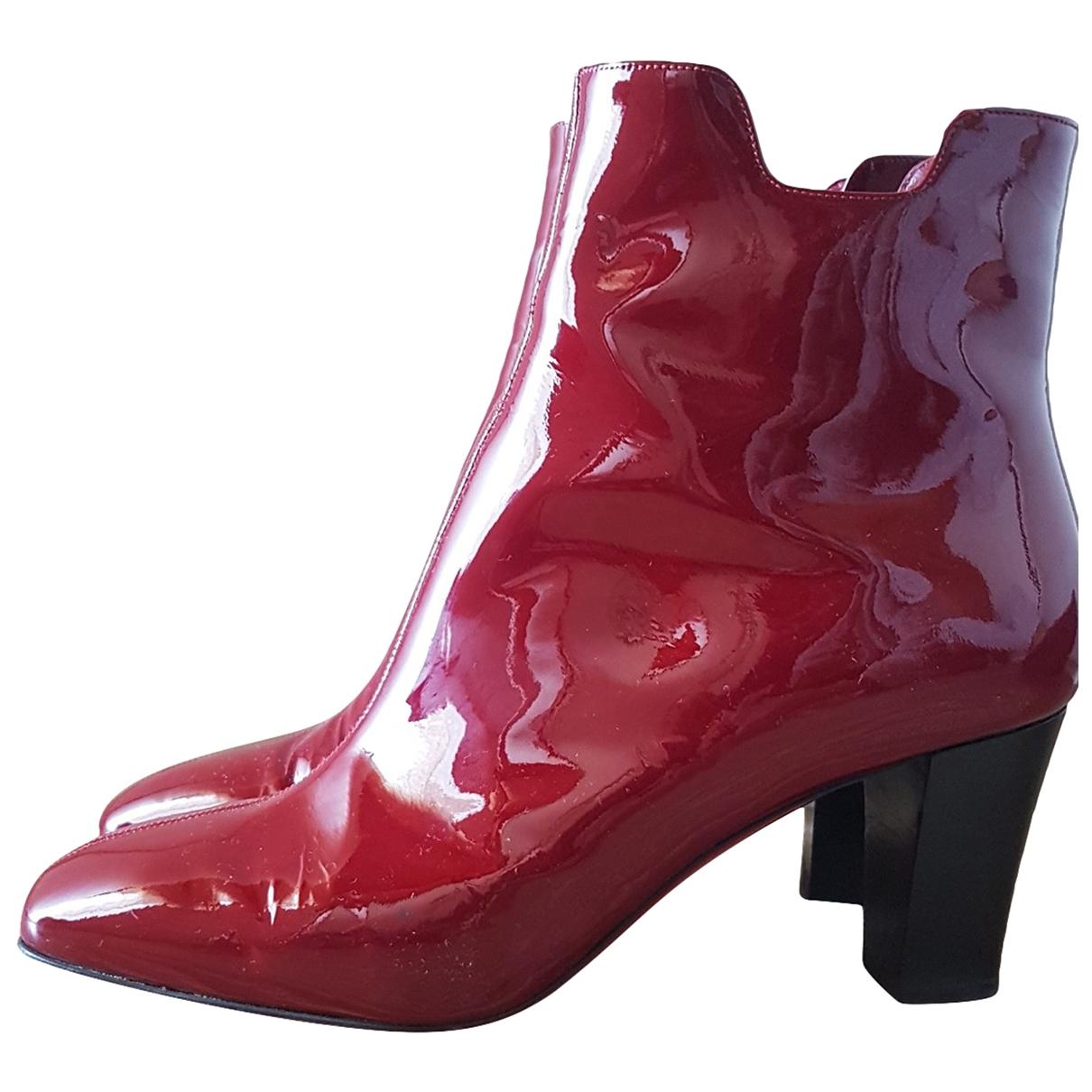 Christian Louboutin - Boots   pour femme en cuir verni - bordeaux