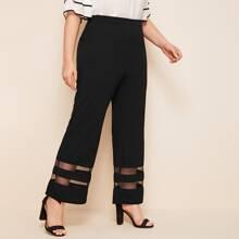 Hose mit Netzeinsatz und ausgestelltem Beinschnitt