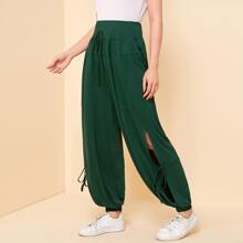 Hose mit breitem Taillenband, Knoten und Schlitz