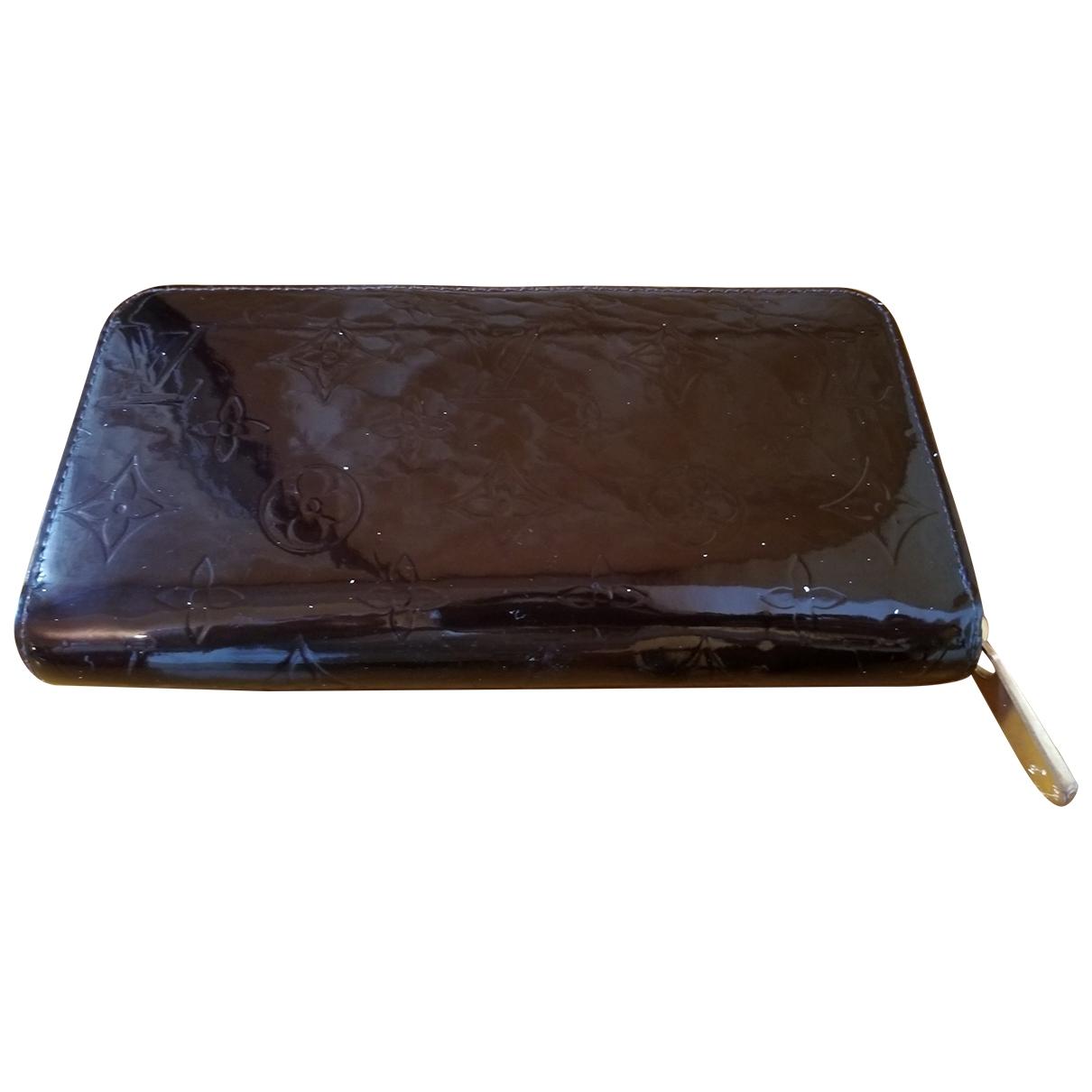 Louis Vuitton - Portefeuille Zippy pour femme en cuir verni - bordeaux