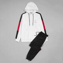 Conjunto capucha con letra con pantalones con costura lateral en contraste