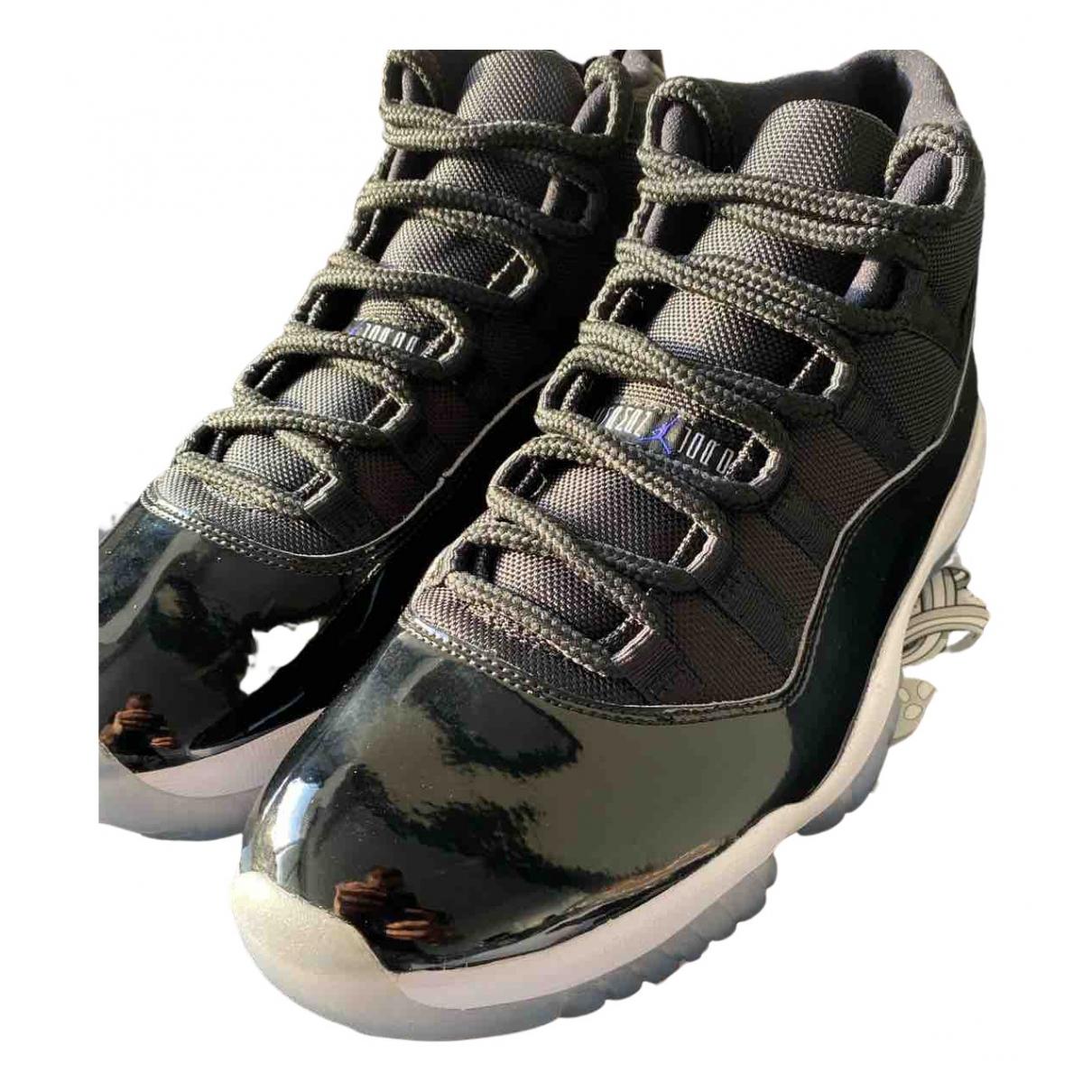 Jordan Air Jordan 11 Sneakers in  Schwarz Kautschuk