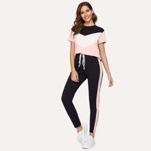 Conjunto camiseta de cheuron con leggings con costura lateral en contraste