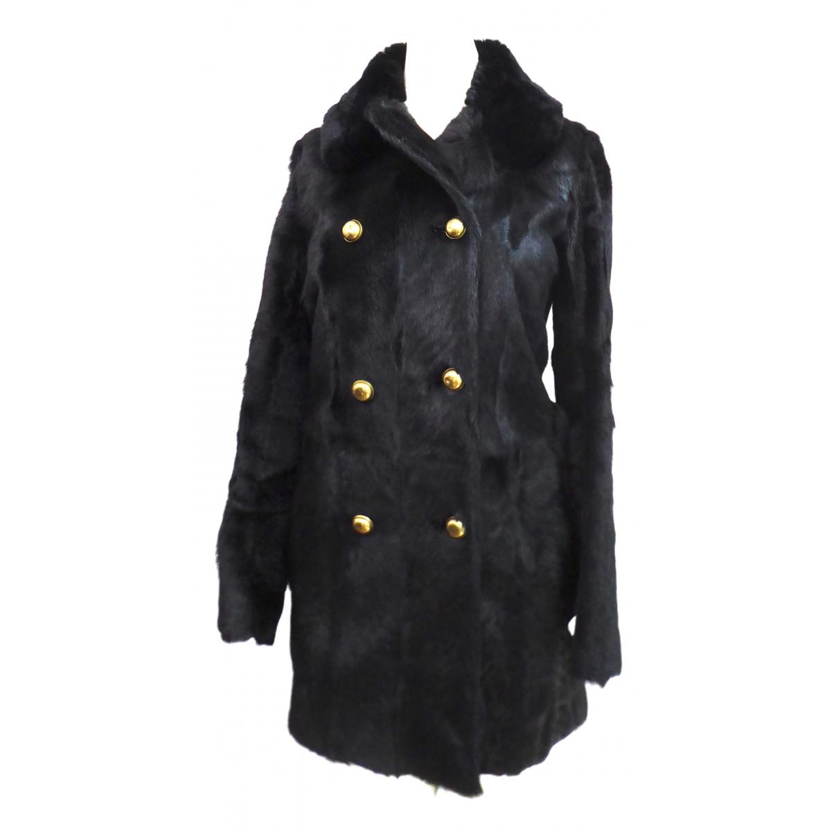 Valentino Garavani - Manteau   pour femme en fourrure - noir