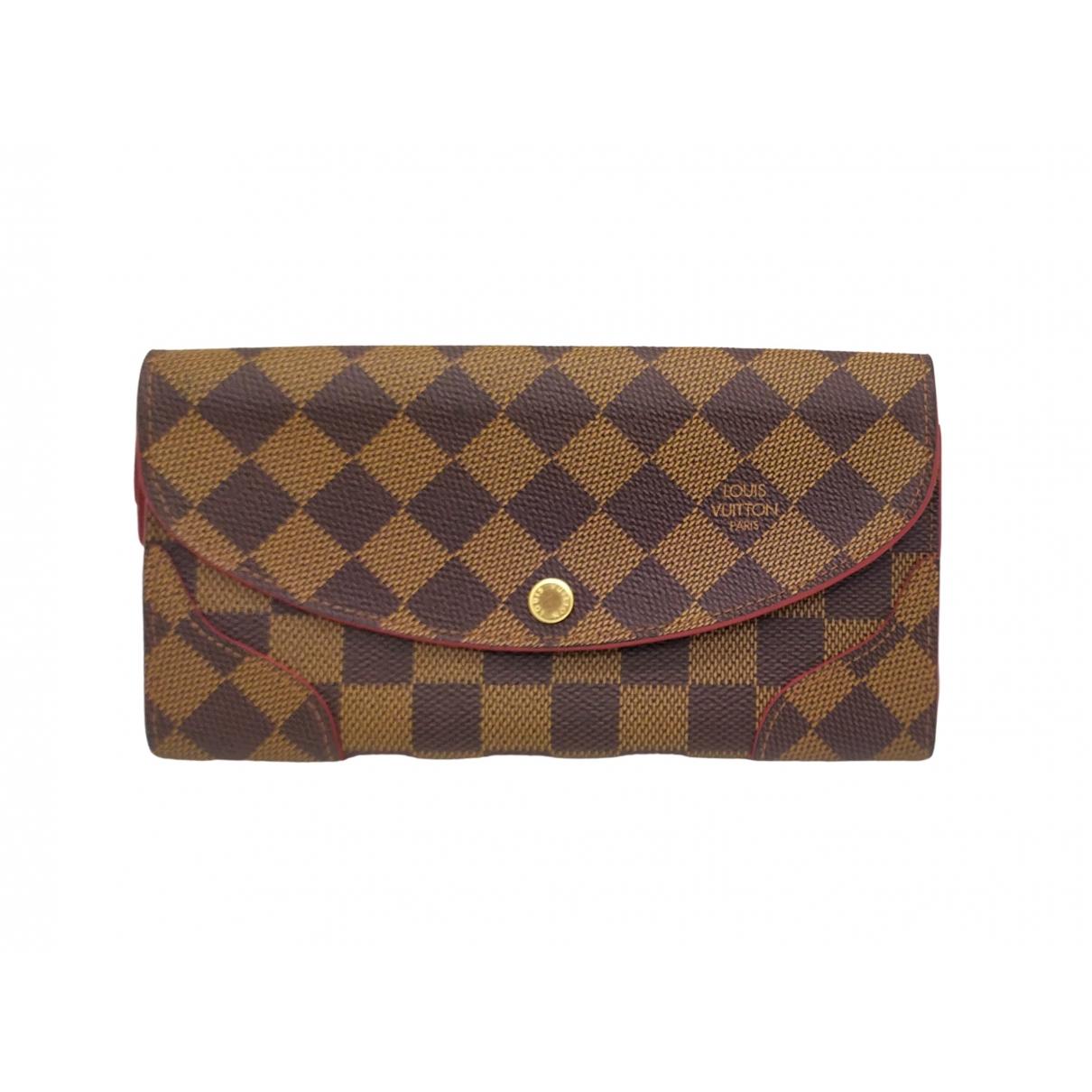 Louis Vuitton - Portefeuille Emilie pour femme en toile - rouge