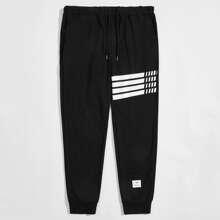 Pantalones con parche de rayas