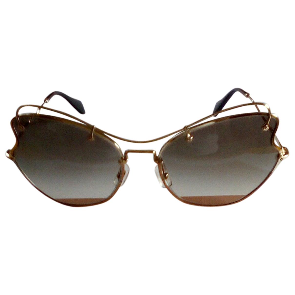 Miu Miu \N Sonnenbrillen in  Gold Metall