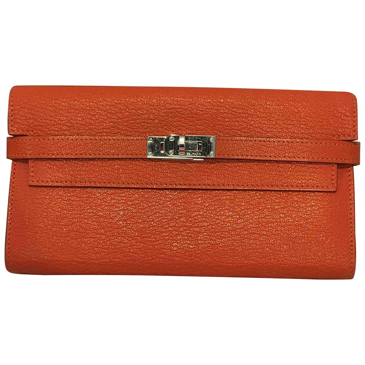Hermes Kelly Portemonnaie in  Orange Leder
