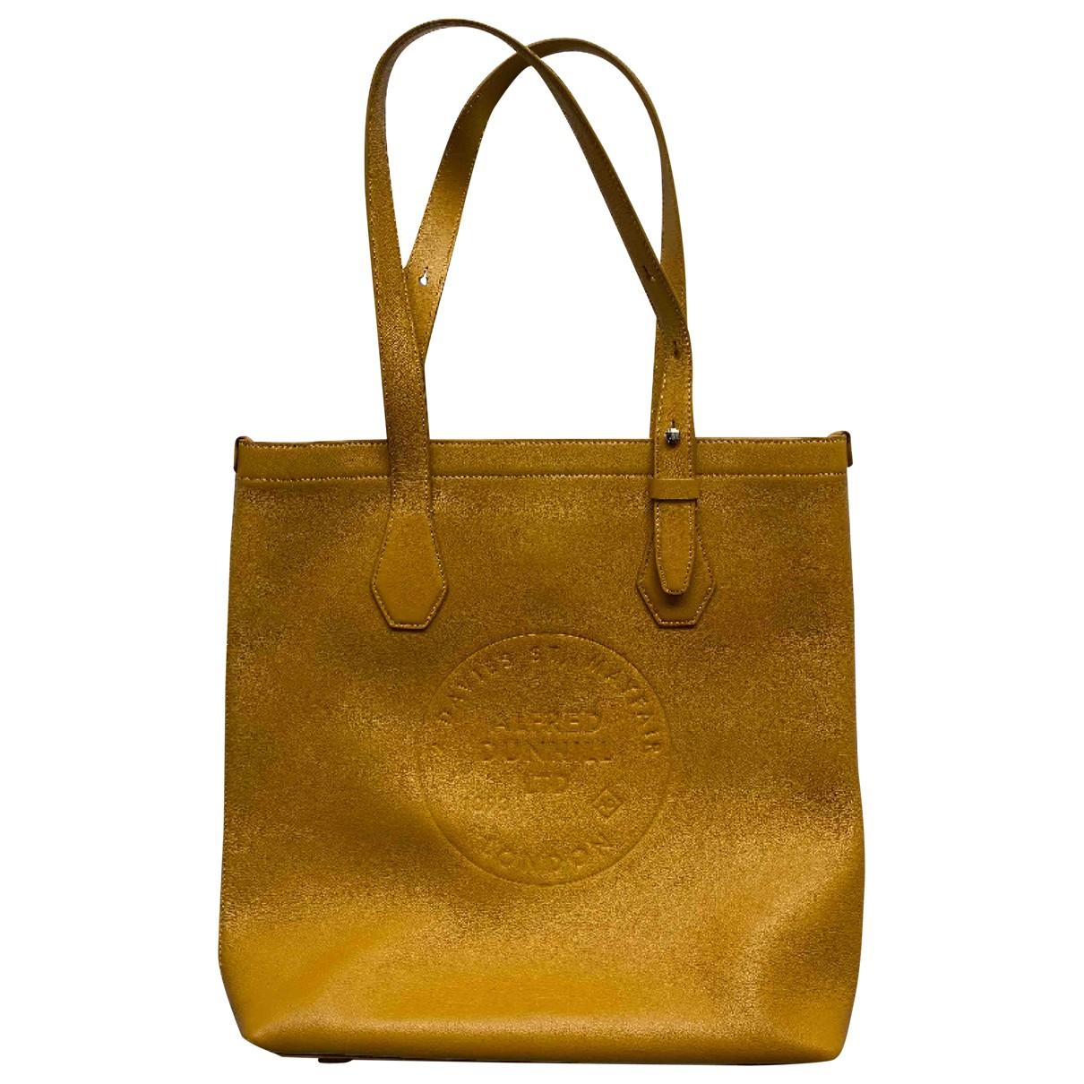 Alfred Dunhill - Sac de voyage   pour femme en cuir - jaune
