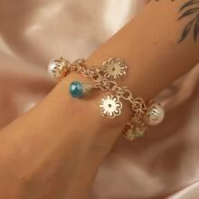 Armband mit Kunstperlen