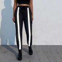 Pantalones cargo con cinta reflexiva de cintura con cordon