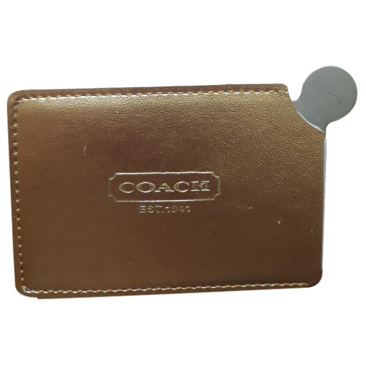 Coach \N Accessoires und Dekoration in  Gold Leder