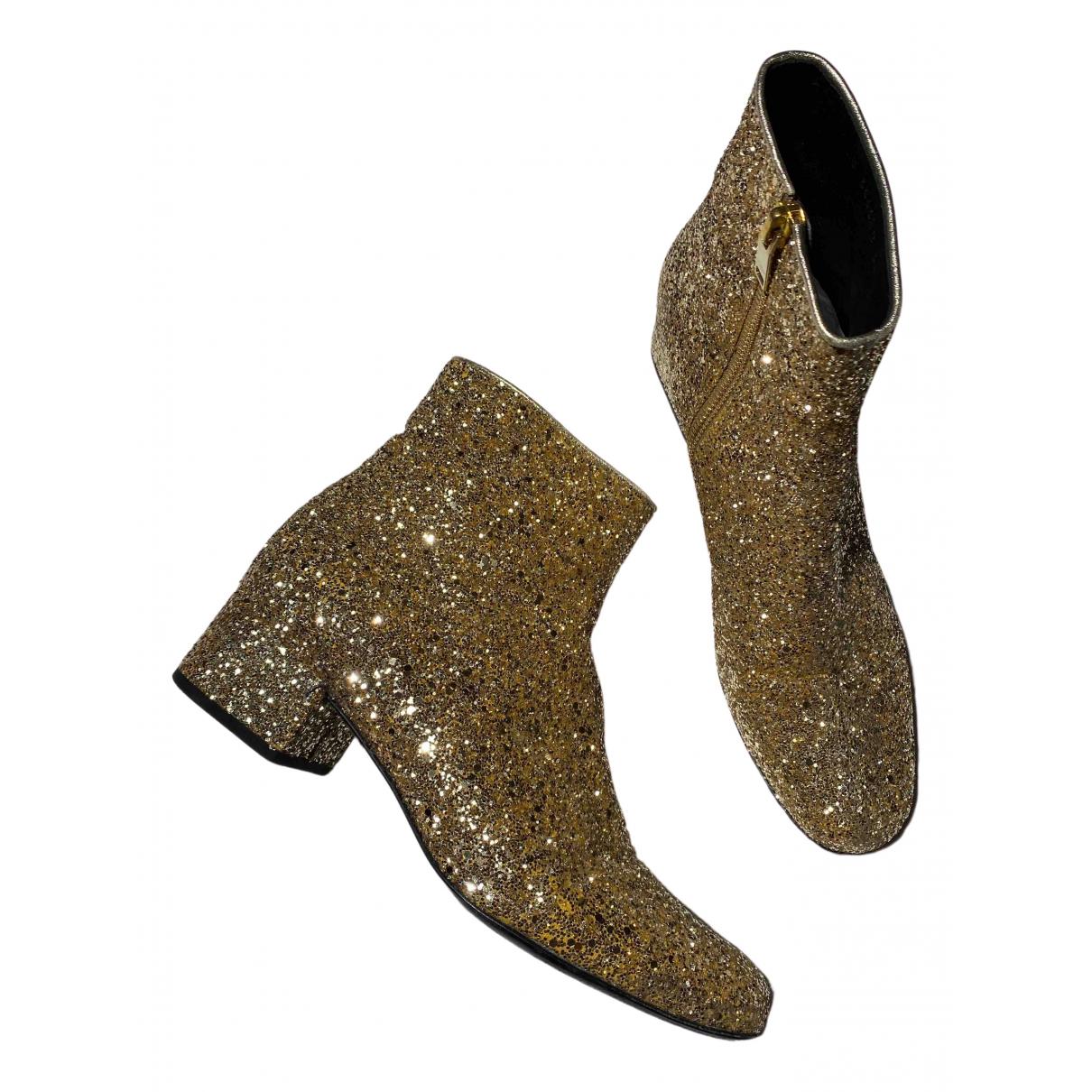 Saint Laurent \N Gold Glitter Ankle boots for Women 38 EU