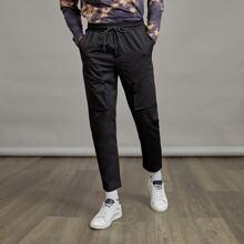 Pantalones con bolsillo oblicuo de cintura con cordon