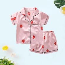 Conjunto de pijama de saten de niñitas ribete en contraste con fresa