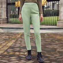 Pantalones ajustados unicolor con cremallera trasera