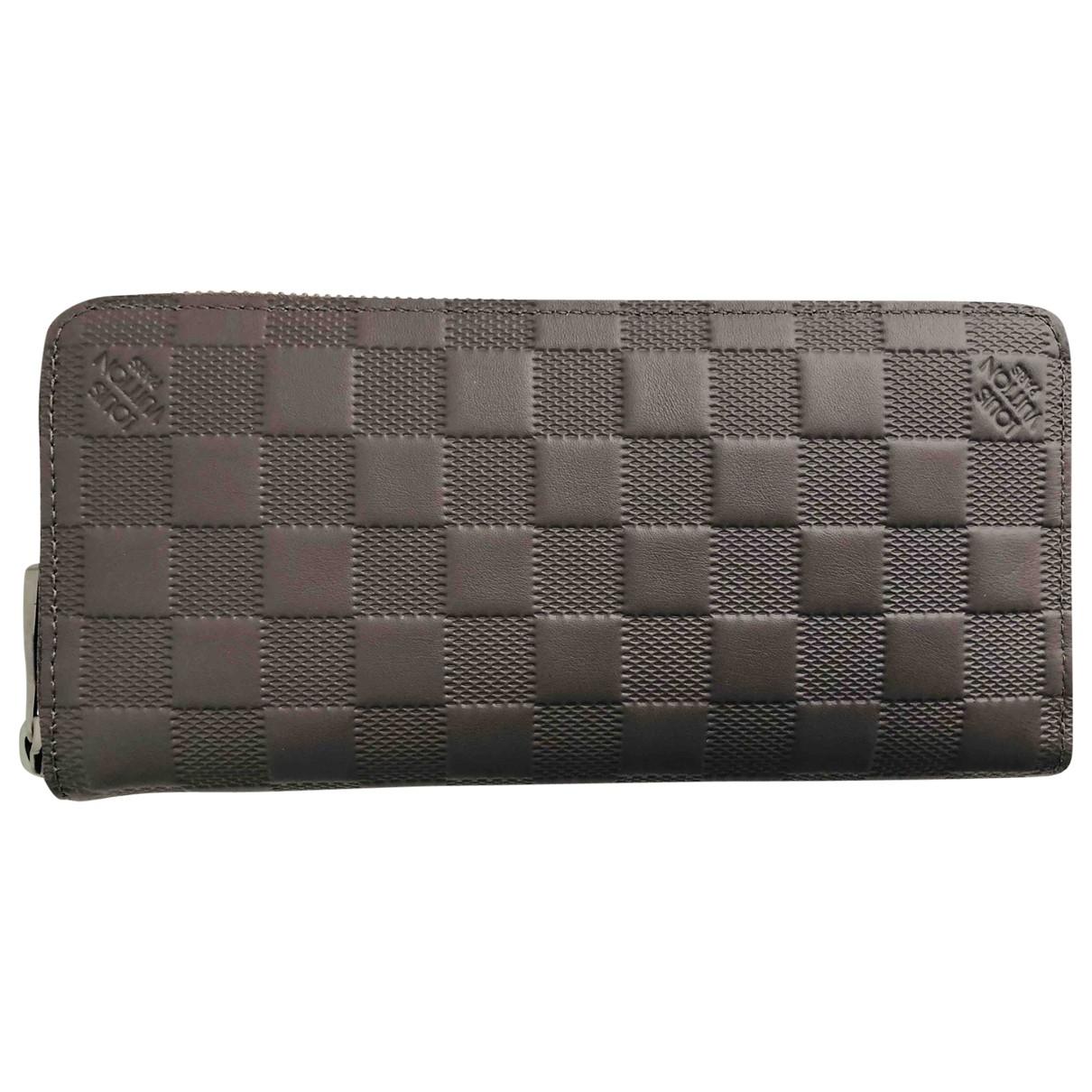 Louis Vuitton - Petite maroquinerie Zippy XL pour homme en cuir - marron