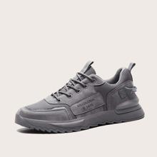 Zapatillas deportivas de hombres con estampado de letra