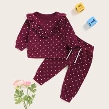 Camiseta de bebe niña de lunares ribete fruncido con pantalones
