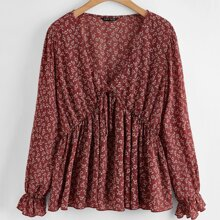 Camisa peplum floral con cordon delantero