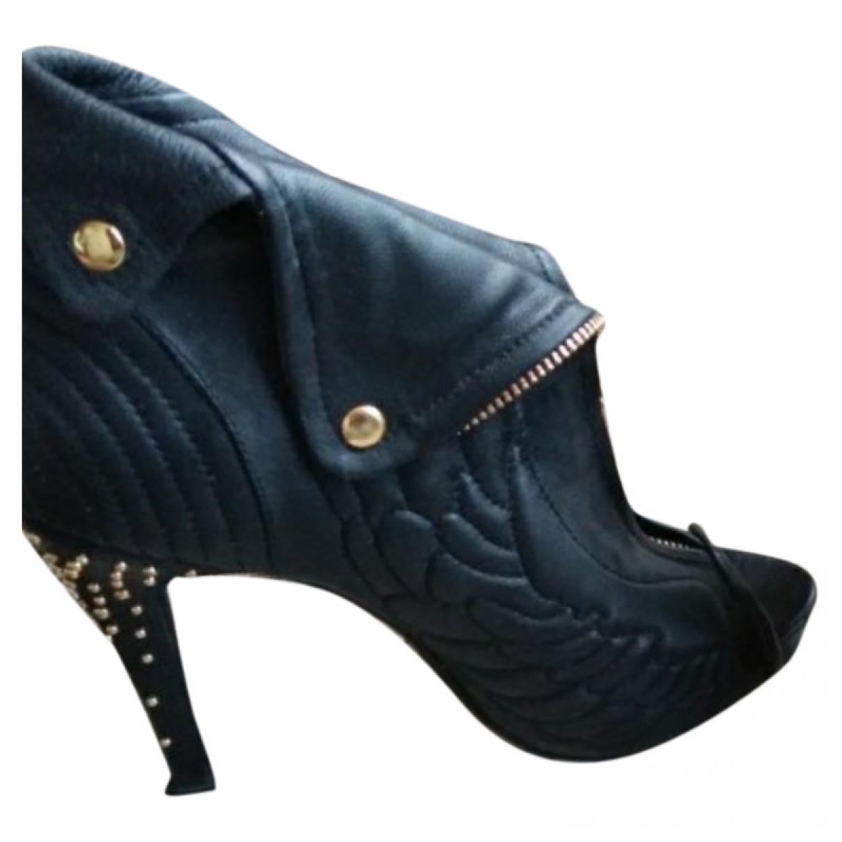 Alexander Mcqueen - Boots   pour femme en cuir - noir