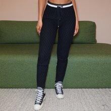 Pantalones jersey tejidos de cable de cintura con cordon en contraste