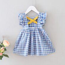 Kleid mit Karo Muster, Kreuzgurt hinten und Ruesche