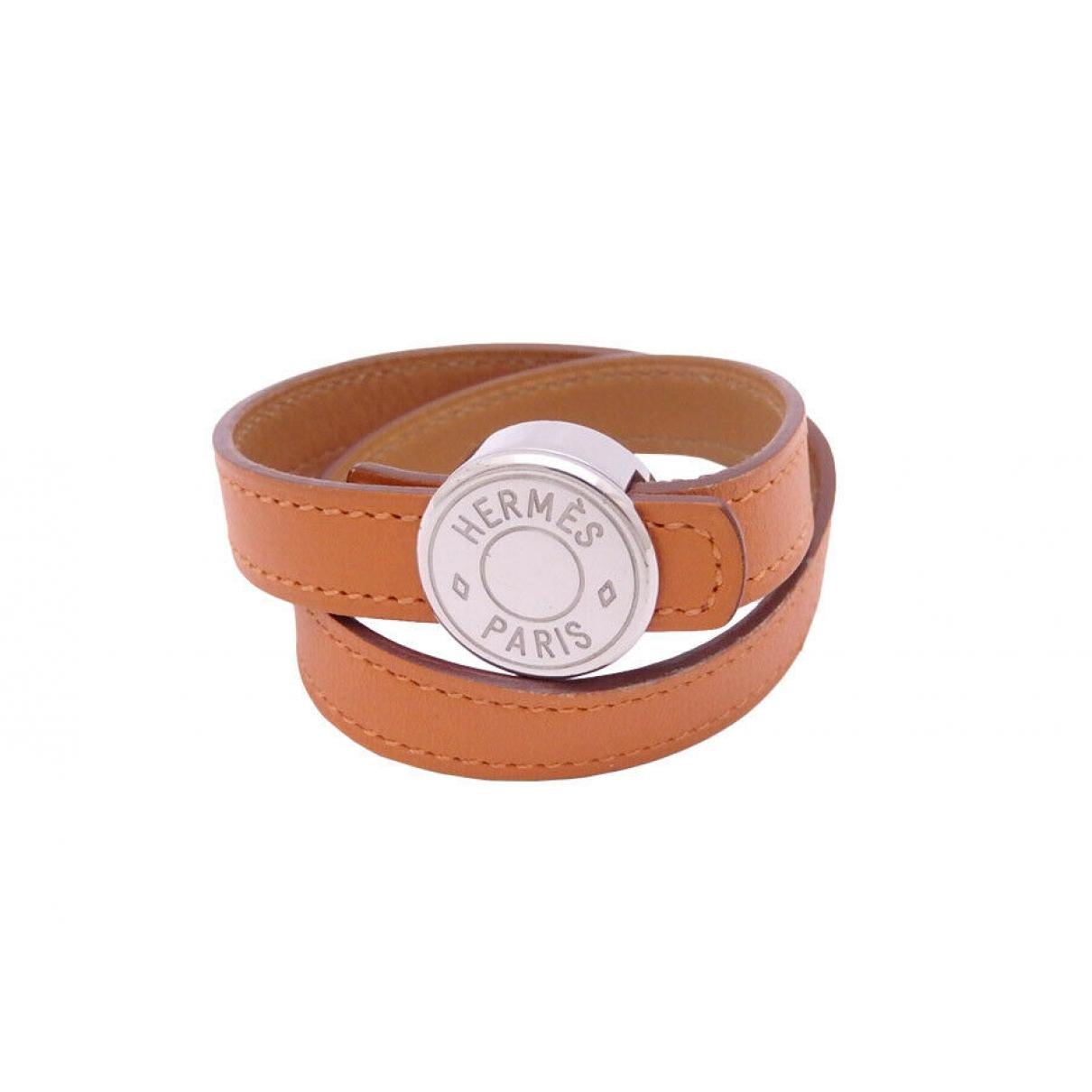 Hermes Clou de Selle Armband in  Orange Leder