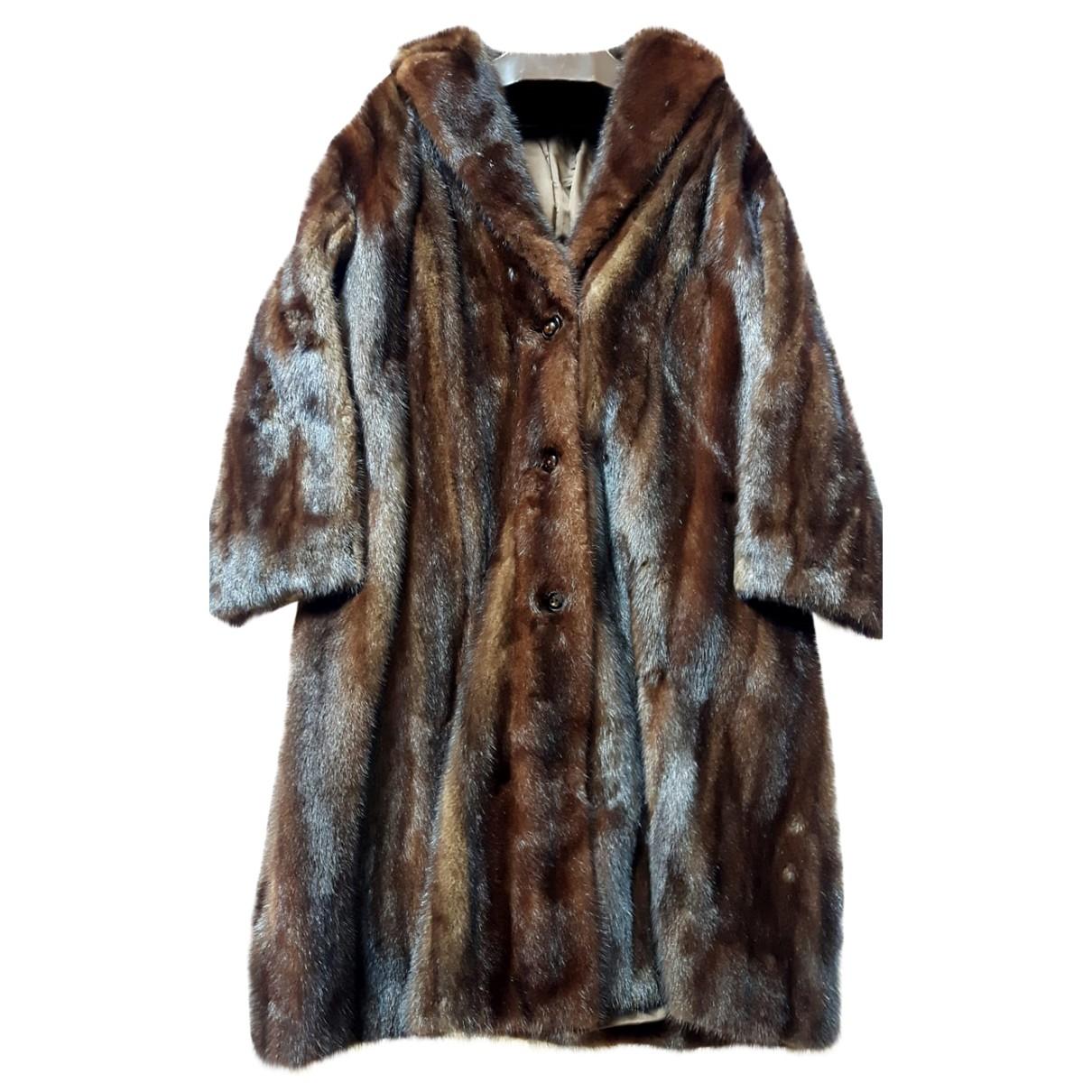 - Manteau   pour femme en fourrure
