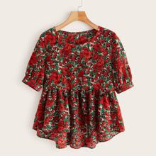 Camisa asimetrica con estampado floral