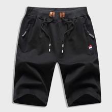 Shorts track de hombres con cordon con diseño de cremallera