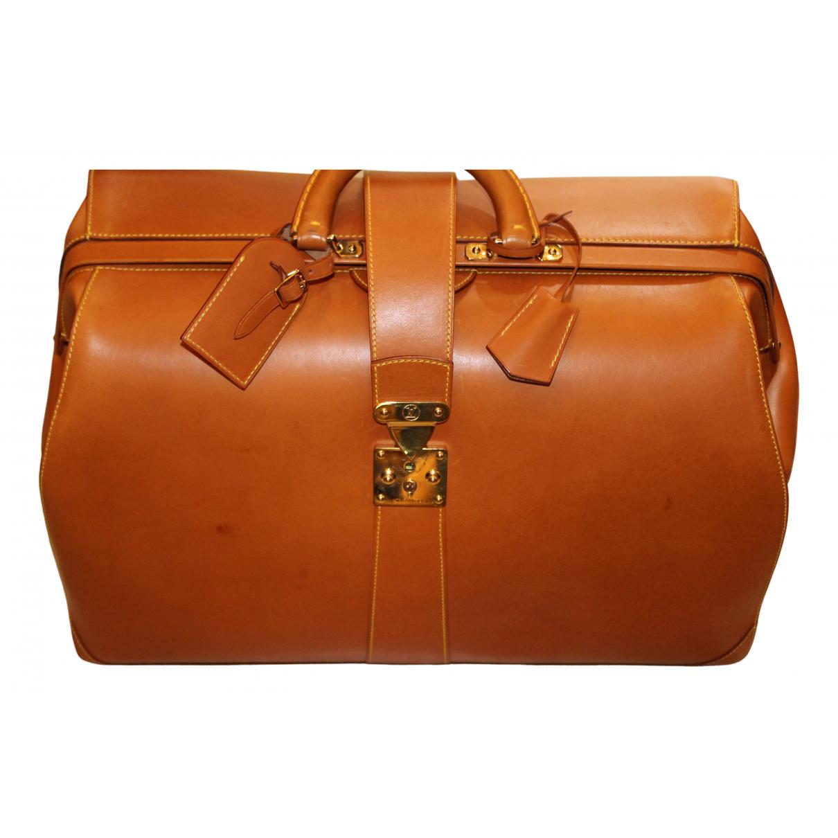 Louis Vuitton - Sac de voyage   pour femme en cuir - beige