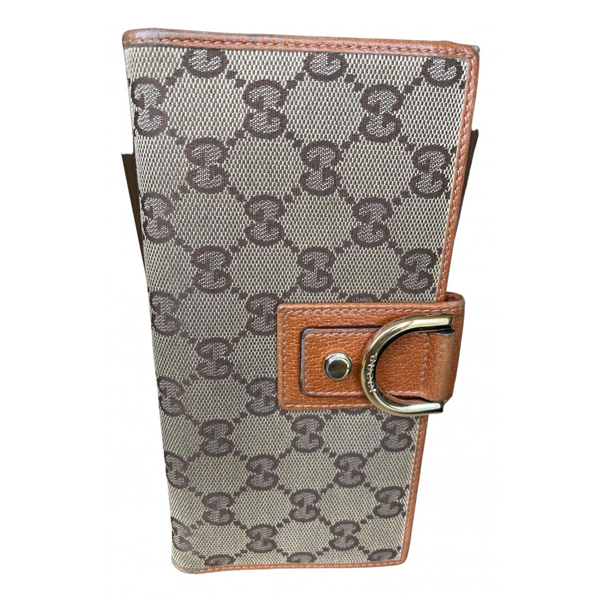 Gucci \N Portemonnaie in  Braun Leinen