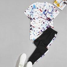 Camiseta con patron de salpicadura de pintura con joggers con cordon