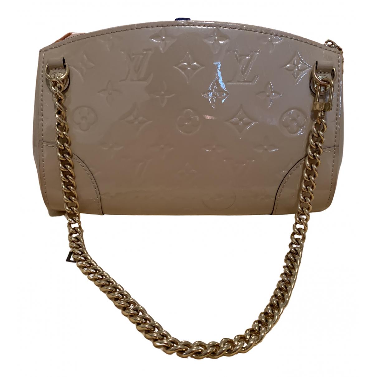Louis Vuitton - Pochette   pour femme en cuir verni - beige