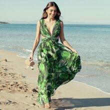 Kleid mit tropischem Muster, tiefem Kragen und Ausschnitt Detail