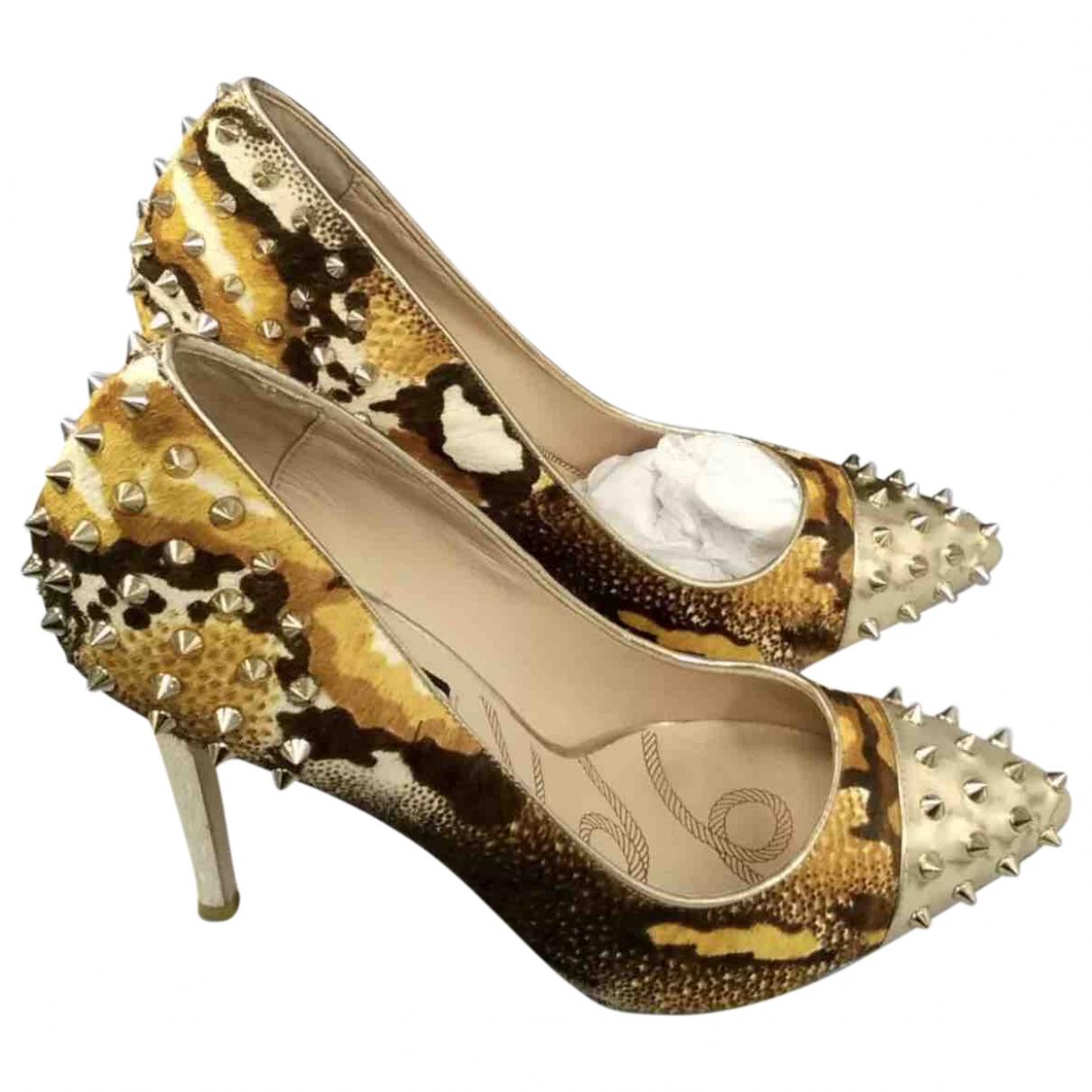 Lucy Choi \N Pumps in  Gold Leder