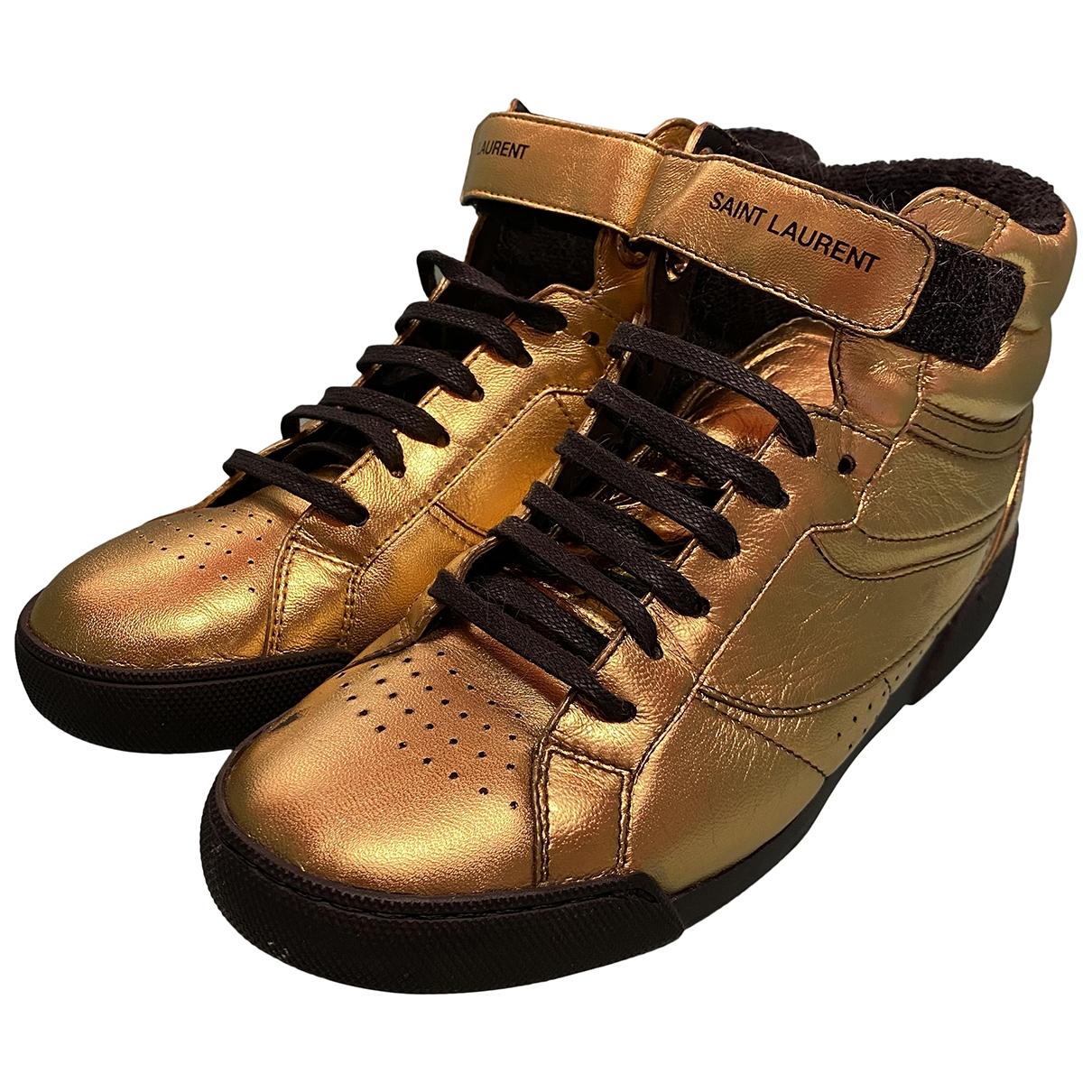 Saint Laurent \N Gold Leather Trainers for Women 37 EU